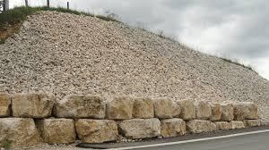 bloc de pierre pour mur tattu tp terrassement de plate forme nivellement de décharge