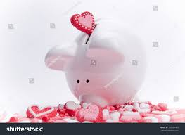 heart shaped piggy bank piggy bank heartshaped candies stock photo 199367405