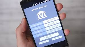 online banking application demonstrated on a tablet device stock