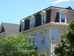 exterior fabulous dormer windows and mansard roof with soffits