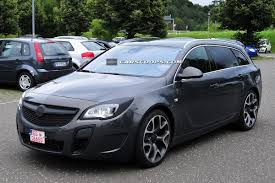 opel insignia 2014 scoop facelifted opel insignia sports tourer wears its opc power