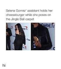 selena gomez assistant holds her cheeseburger while she poses on