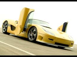 koenigsegg cc8s wallpaper 2005 koenigsegg ccr yellow side angle open doors 1024x768