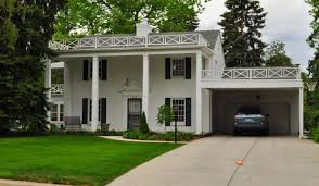 affordable houses with garages that has cream concrete floor can