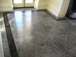 marble tile flooring and trendy faux hardwood flooring on floor
