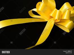 black and yellow ribbon yellow ribbon on black background image photo bigstock
