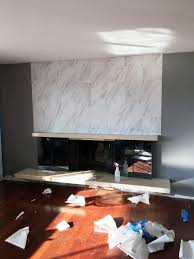 reface fireplace with marble would do brick instead of marble