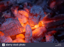 Wood Burning Firepit by Glowing Embers And Ash From Within A Wood Burning Firepit Stock