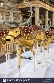 a large display of reindeer made of lego bricks outside