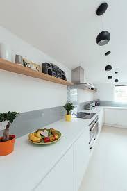Interiors Kitchen by Corian Worktop Kitchen With Matt White Units Grey Glass