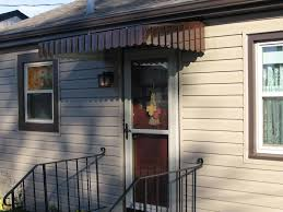 Awnings For Homes At Lowes Backyards Blake Aluminum Awnings Alum 02 Big Door Lowes