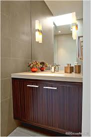 wall mount sink with towel bar a chandelier above the luminous and round white sink and plain
