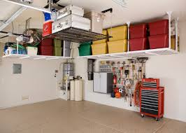 home garage design maximizing small spaces garage design using overhead storage