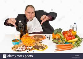 table full of food overweight man sitting at a table full of food stock photo 78072035