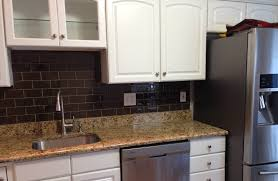 interior grey glass subway tile backsplash with floating dark