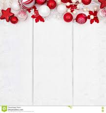 red and white christmas ornament top border over white wood stock