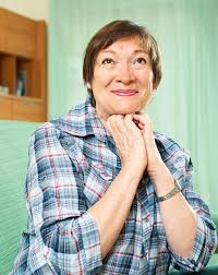 elderly woman clothes elderly woman in casual clothes sitting on stock photo