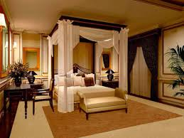 romantic master bedroom with canopy bed and sculptural wrought