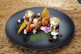 magazine cuisine en ligne fish tower with aligned prawns hospitality food wine monthly
