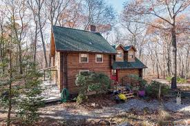 log cabin escapes william pitt sotheby u0027s realty