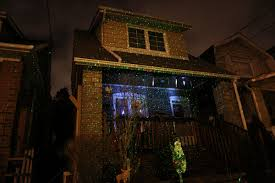 Laser Projector Christmas Lights by Projection Spotlights Illuminate Neighbourhoods Ahead Of The