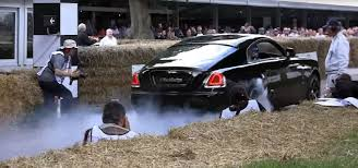 modified rolls royce rolls royce wraith performing a burnout is like seeing the queen