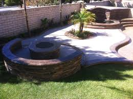 spa waterfall stamped concrete pavers planter fire pit