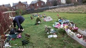 visits stillborn s grave to see another child buried in