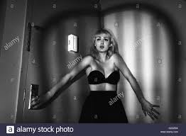 Corner Of Room by Frightened Young Woman In Corner Of Room With Overlapping Shadow