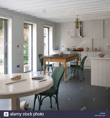 kitchen dining room with white painted pedestal table an wood