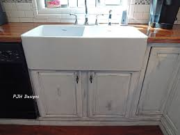 interior design white apron sink with graff faucets for modern