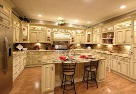 pictures of kitchens with antique white cabinets off white kitchen cabinets with antique brown granite home design