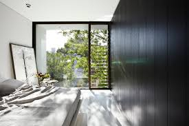 jalousie windows bedroom contemporary with black wall black wood