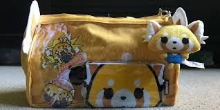 meet hello kitty u0027s aggretsuko and her ai tata bag geekmom