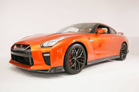 nissan sports car despite flagging sales nissan ceo ghosn says sports cars still