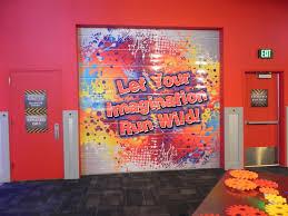 wonderworks roll up garage door mural extreme vinyl graphics vinyl wall murals and signs for wonderworks