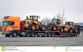 scania r500 truck hauls three wheel loaders editorial photography