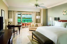 st thomas suites the ritz carlton st thomas a bright and spacious guest room opens onto a balcony with ocean views