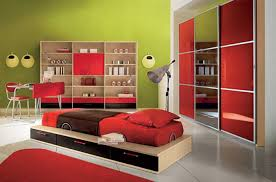 large kids bedroom design with red bed and brown quilt green wall