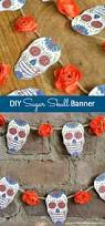 decorate for day of the dead with this diy sugar skull banner