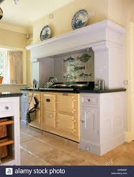 cream aga double oven in fitted white unit in traditional country