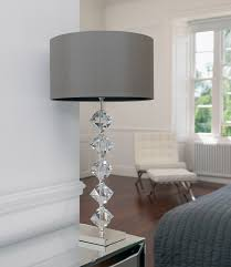 contemporary transparent grey crystal table lamp white wall paint