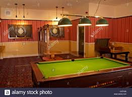 the new market pub games room with pool table and darts boards
