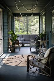 before and after a summer porch rehab in upstate new york rug consider a round braided jute rug available in two neutral colors and in two diameters at prices ranging from 159 to 259 from ballard designs