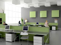 minimalist office desk layout with white soft green color schemes