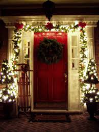 main door flower designs red wooden main door with green wreath and green garland with