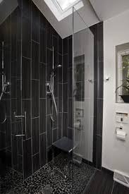 black subway tile bathroom towel shelves on the wall white floor