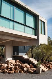 elevated home designs elevated house responds to a rocky site through stylish design