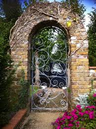 rod iron gates exterior traditional with brick wall garden gate