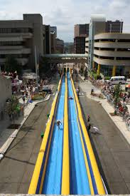starting next week massive water slides will invade cities across